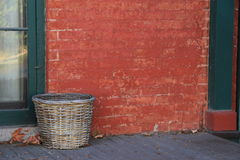 Hand woven basket on old wood porch Stock Photography