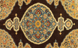 Hand Woven Carpet Background Abstract Design. A hand woven carpet is shown with detail closeup giving a nice abstract background design Stock Photo
