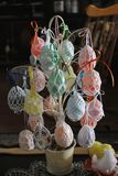 Hand Woven Easter Egg Holders. Unique hand woven easter egg holders with metal tree and pot. Traditional easter colors and each holder is different from the Royalty Free Stock Image