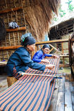 Hand-woven elderly. Now, although many fabrics are machine textile, but still have the presence of the handicraft industry Stock Images