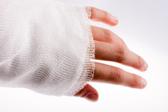 Hand wrapped in bandage Stock Images