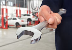 Hand with wrench. Auto mechanic. Hand with wrench. Auto mechanic in car repair royalty free stock image