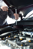 Hand with wrench. Auto mechanic in car repair Stock Photos