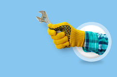 Hand with a wrench on a blue background. Banner repairs Royalty Free Stock Image