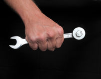 Hand and Wrench Royalty Free Stock Images
