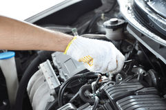 Hand with wrench repairing car engine Royalty Free Stock Photos