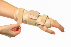 Hand with a wrist brace. Isolated Royalty Free Stock Photography