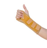 Hand with a wrist brace, orthopedic equipment isolated on white,. Insurance concept Stock Image