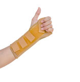 Hand with a wrist brace, orthopedic equipment isolated on white,. Insurance concept Stock Photo