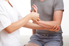Hand and wrist examination royalty free stock photo