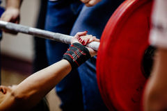 Hand wristbands young girl powerlifter stock photos