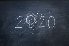 Hand Write 2020 With Light Idea On Blackboard Royalty Free Stock Photos