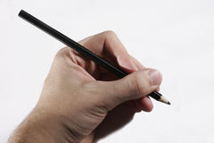 Hand write. Hand writing with black pencil - Not left handed, though could be mirrored to provide right handed image Royalty Free Stock Image
