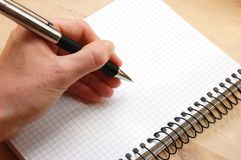 Hand write a message. On empty notebook Stock Image