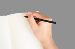 Hand write on notebook on gray background with clipping path Royalty Free Stock Photos