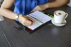 Hand write notebook. Isolated on wooden table background Royalty Free Stock Photo