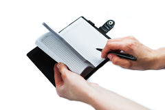 Hand write on notebook on white background Stock Photos