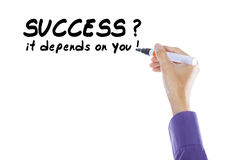 Hand write success it depends on you Stock Photos