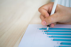 Hand write on Various financial charts Stock Images