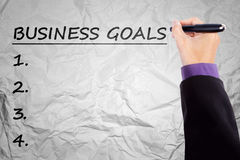 Hand writes business goals on crumpled paper royalty free stock photos