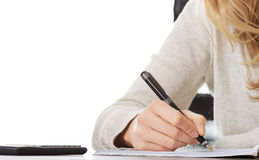 Hand writes with a pen in a notebook stock photos