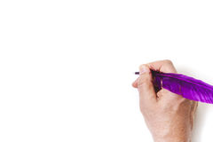 Hand writes, purple pen on white background Royalty Free Stock Image
