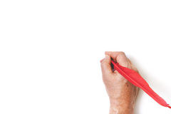 Hand writes red pen on white background Royalty Free Stock Photo