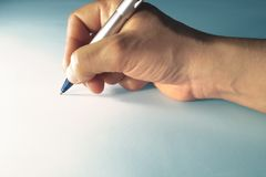 Hand writing. A hand writing with a silver pen Royalty Free Stock Images