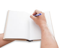 A hand is writing Stock Photography