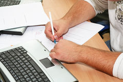 Hand writing. In business environment Royalty Free Stock Photos