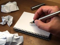 Hand writing. With foutain pen over white notebook Stock Images