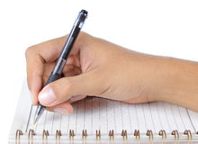 Hand writing on abook Stock Image
