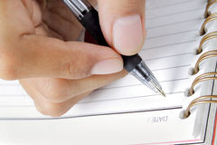 Hand writing on abook Royalty Free Stock Photo