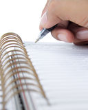 Hand writing on abook Royalty Free Stock Images