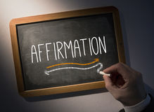Hand writing Affirmation on chalkboard Stock Photography