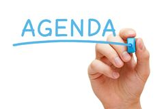 Agenda Handwritten With Blue Marker. Hand writing Agenda with blue marker on transparent wipe board royalty free stock photos