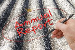 Hand writing `Annual Report` on a background image representing an asbestos roof royalty free stock photography