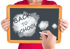 Hand writing Back to school text on blackboard Royalty Free Stock Image
