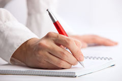Hand writing with ballpoint pen Royalty Free Stock Photography