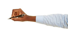 Hand writing with ballpoint pen. Hand of african man writing with a ballpoint pen Stock Photo