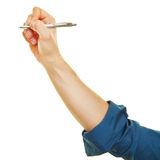 Hand writing with ballpoint pen. Side view of hand writing with a ballpoint pen Royalty Free Stock Photo