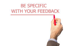 Hand writing BE SPECIFIC WITH YOUR FEEDBACK Royalty Free Stock Photos
