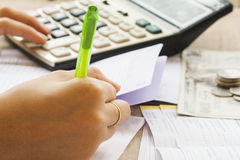 Hand writing bill deposit with passbook bank for financial expenses and income. On office desk Stock Image