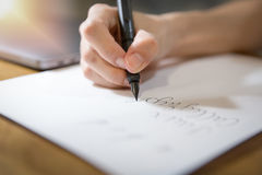 Hand writing with black fountain pen on white paper Stock Photography
