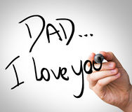 Hand writing with black mark on a transparent board - Dad, I love You.  stock photo