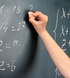 Hand writing on blackboard Stock Images