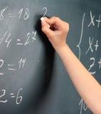 Hand writing on blackboard Stock Images