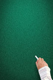 Hand writing on blank blackboard Royalty Free Stock Images