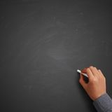 Hand writing on blank chalkboard Stock Image