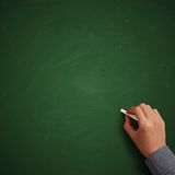 Hand writing on blank green chalkboard Royalty Free Stock Photo